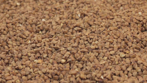 Rotation of the background of whole grains of buckwheat. Close-up Footage