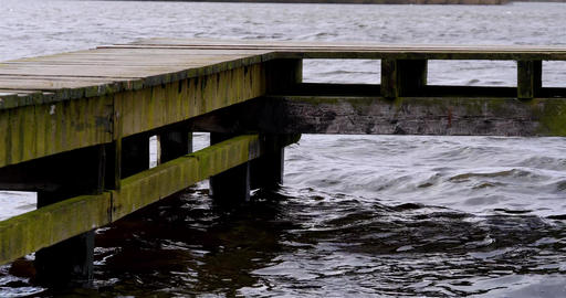 Pier or jetty in lake during storm Footage