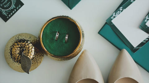 Wedding rings on a table in a beautiful box Footage