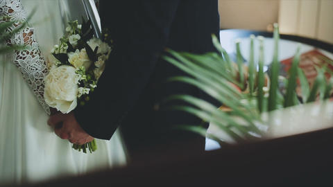 Loving couple holding a wedding bouquet in hands Footage
