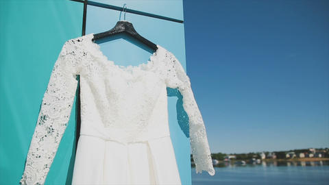 Wedding dress on the balcony on the river bank and the blue sky Image