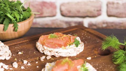 Smoked salmon on rice bread toasts Footage