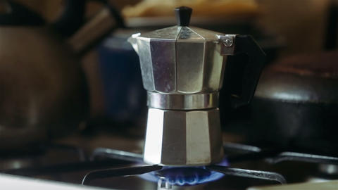 Moka pot brewing on a gas stove. Taditional way of brewing Italian coffee Live Action