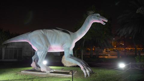 Dubai, UAE - January 13, 2018: realistic figure predatory Deinonychus dinosaur Footage
