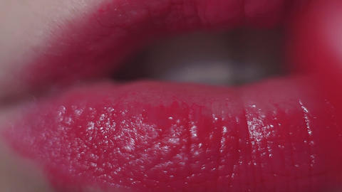 Female apply rose lipstick on lips close up Footage