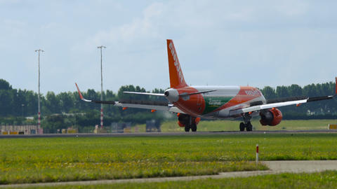 Airbus A320 of Easy Jet Airlines with Europcar livery taxiing Footage