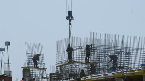 Workers at building under construction 영상물