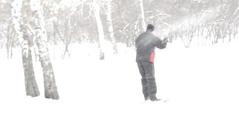 Man skier riding in the Park during snowfall in winter in Siberia Live Action