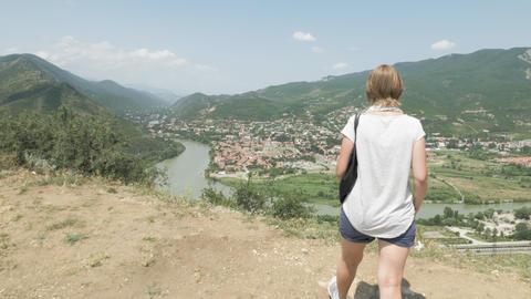 Girl walks and looks at Mtskheta from Jvari area - Georgia Footage
