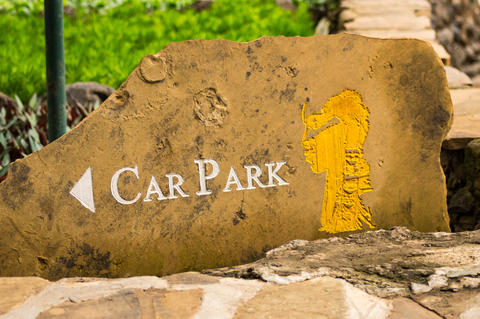 Parking sign for car engrave in a stone with a masai face Photo