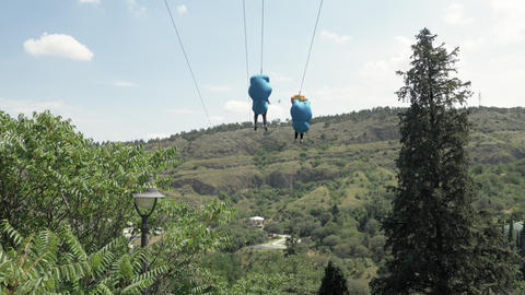 Two people taking zipline ride at Tbilisi - Georgia Live Action