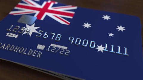 Plastic bank card featuring flag of Australia. National banking system related Footage
