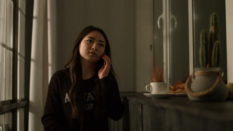 Attractive asian girl talking on mobile phone Live Action