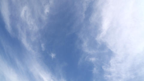 Slow flying and rotation of cloudy blue sky 画像