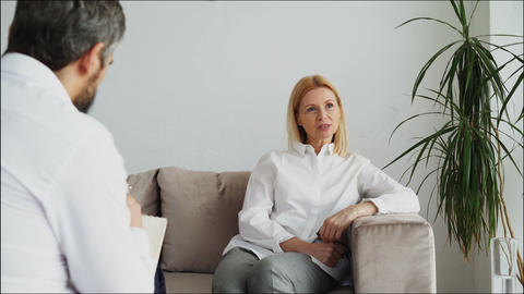 Male psychoanalyst listening adult female patient and... Stock Video Footage
