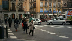 Madrid, Spain - February 1, 2018: People crossing the street at the traffic Archivo