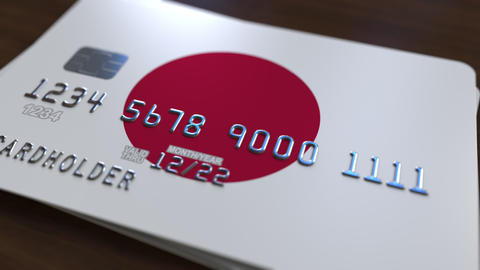 Plastic bank card featuring flag of Japan. National banking system related 영상물