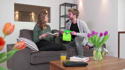 Couple At Home Man Giving Birthday Present Gift To Woman Footage
