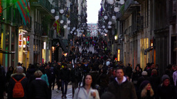 People crowd walk at Carrer Ferran, slow motion, twiligh time Footage
