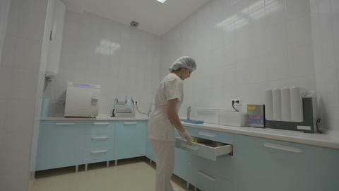 Dental Nurse Preparing Medical Instruments stock footage