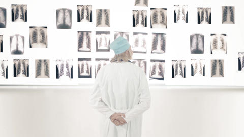 Doctor Looking At X-Ray On The Wall stock footage