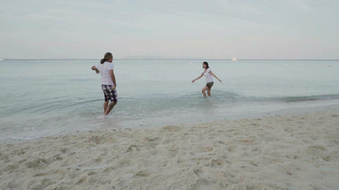 man and woman playing in the sea on theexotic beach Footage