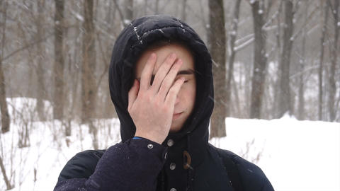 Person facepalming in slow motion 4K. Portrait shot of attractive male person Footage