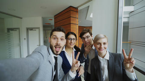 POV of Happy business team taking selfie portrait on smartphone camera and Footage