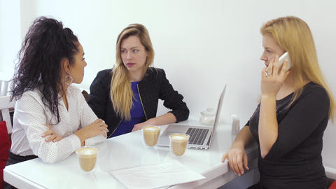 Young women talking with boss on phone sitting at lunch break in cafe Footage