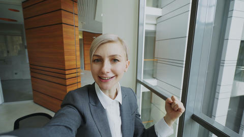 POV of young businesswoman in suit having online video chat using smartphone Footage