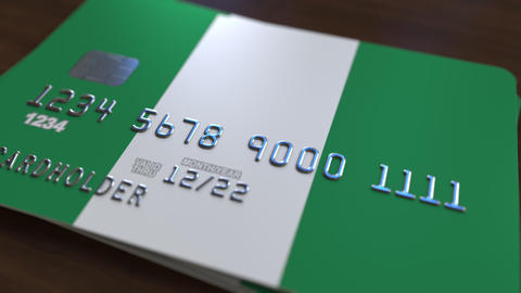 Plastic bank card featuring flag of Nigeria. National banking system related Footage