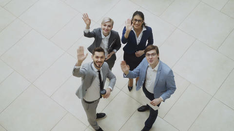 Top view of group of business people in suits discussing financial graphs and Footage