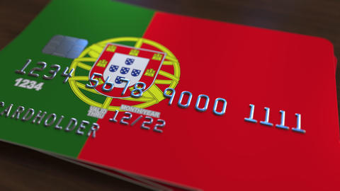 Plastic bank card featuring flag of Portugal. National banking system related Live Action