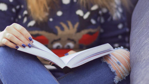 Girl in sweater with book Footage