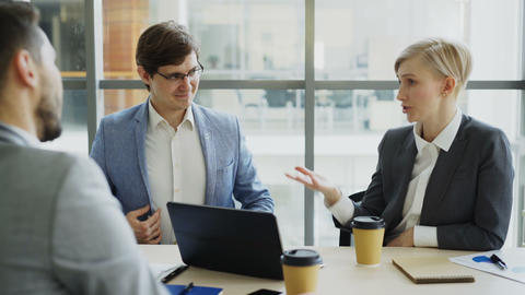 Business team chatting while sitting in modern office indoors during coffee Footage