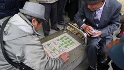 Banqi Chinese board game being played in street Taipei, Taiwan Footage