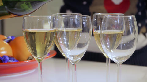 Female pours champagne into glasses Footage