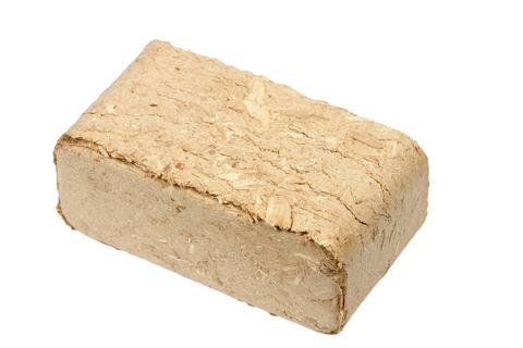 Alternative fuel, bio fuel. Wood sawdust briquettes on white background Photo
