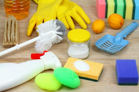 House cleaning products on wooden table Photo