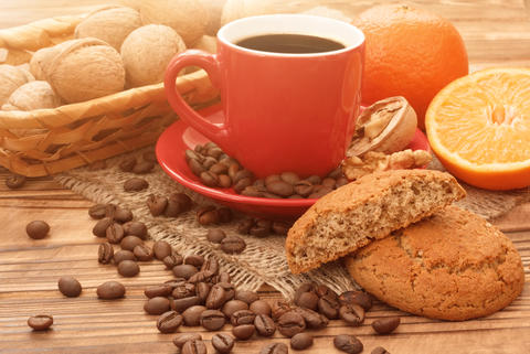 Cup of coffee with cookies and oranges Photo