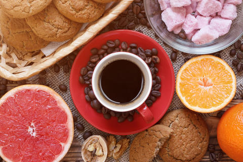 Flat layout with coffee, grapefruit, oatmeal cookies and fruit sugar Photo
