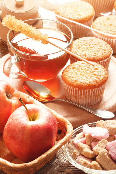 Tea with cupcakes and apples Photo