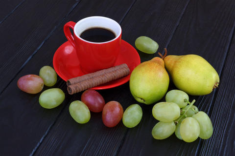 Hot coffee with grapes and fruits Photo