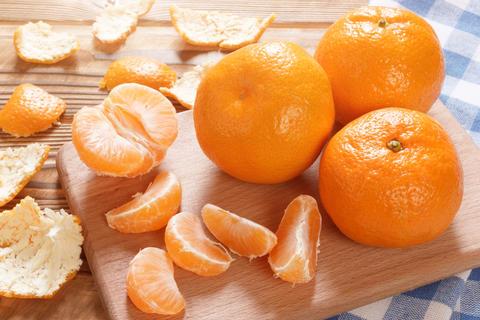 Fresh juicy mandarins closeup Photo
