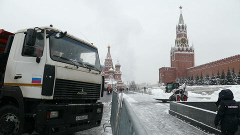 Cleaning the snow near the Kremlin Footage