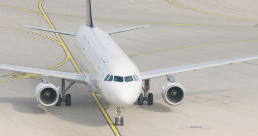 Slow motion shot of passenger airplane taxiing at the airport Footage