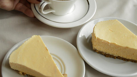 White Cup of coffee and a cheese cake, put a woman on the table, tasty Breakfast Footage