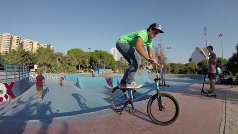 Air Trick on Bike in Skatepark Bowl Slow Motion Footage