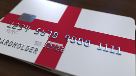 Plastic bank card featuring flag of England. National banking system related Footage