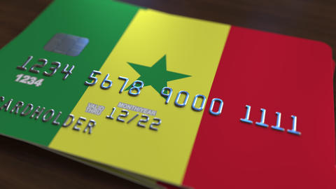 Plastic bank card featuring flag of Senegal. National banking system related Live Action